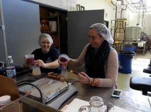 She's not afraid to get her hands dirty. Here Abigail is making wine under the direction of Denise Gardner.