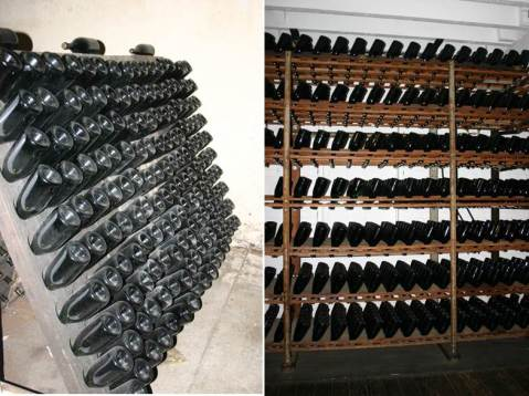 Riddling through traditional riddling racks (left) and an automated system (right).