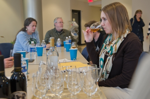 Penn State Extension Enologist, Denise M. Gardner, tastes wines with Wine Quality Improvement (WQI) Short Course attendees to diagnose wine defects/flaws within commercial wines.