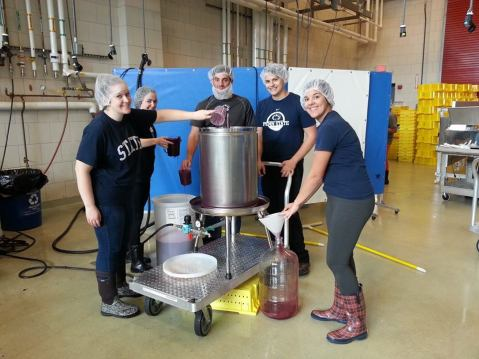 Penn State undergraduate and graduate students pressing 2015 vintage wine. Photo from: Denise M. Gardner