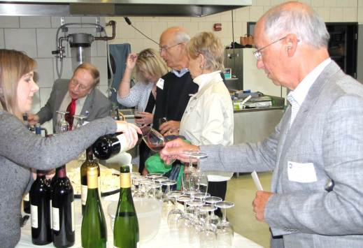 Figure 5: Denise Gardner pours some of the commercial wines for attendees and explains how to pair them with locally produced cheeses. Photo by: Tom Dimick