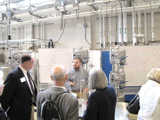 Figure 3: Jared Smith (Dept. of Food Science Teaching Lab Support Specialist and previous graduate supported by the Crouch Endowment) explains how winemakers monitor fermentation and the use of temperature-controlled fermentation tanks. Photo by: Tom Dimick