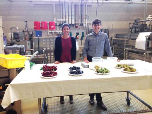 Figure 2: Graduate students, Maria and Drew, get ready to teach attendees about wine grape properties. Maria and Drew are members of Dr. Michela Centinari's research lab. Photo by: Tom Dimick