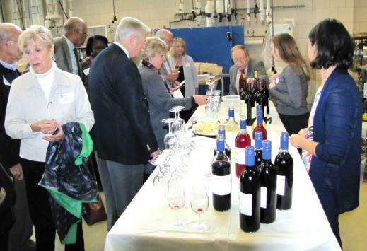 Figure 6: Dr. Michela Centinari pours and explains the research wine trials. Attendees loved this portion of the program and were truly impressed with the quality wines produced by our research team! Photo by: Tom Dimick